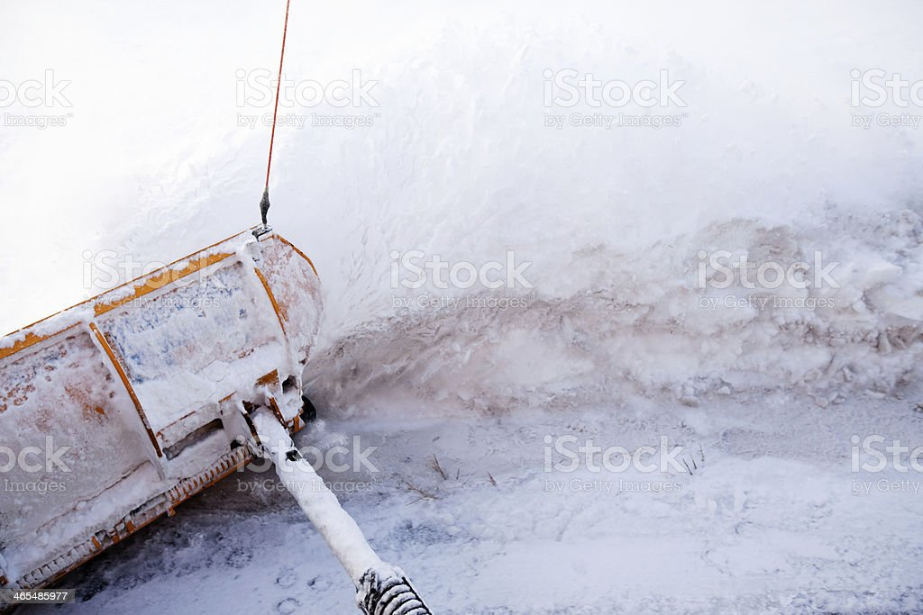Snowplow Wing Plowing Snow from City Street stock photo