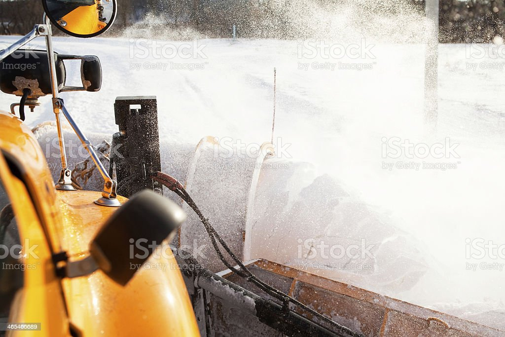 Snowplow with Wing Plowing Snow from City Street stock photo