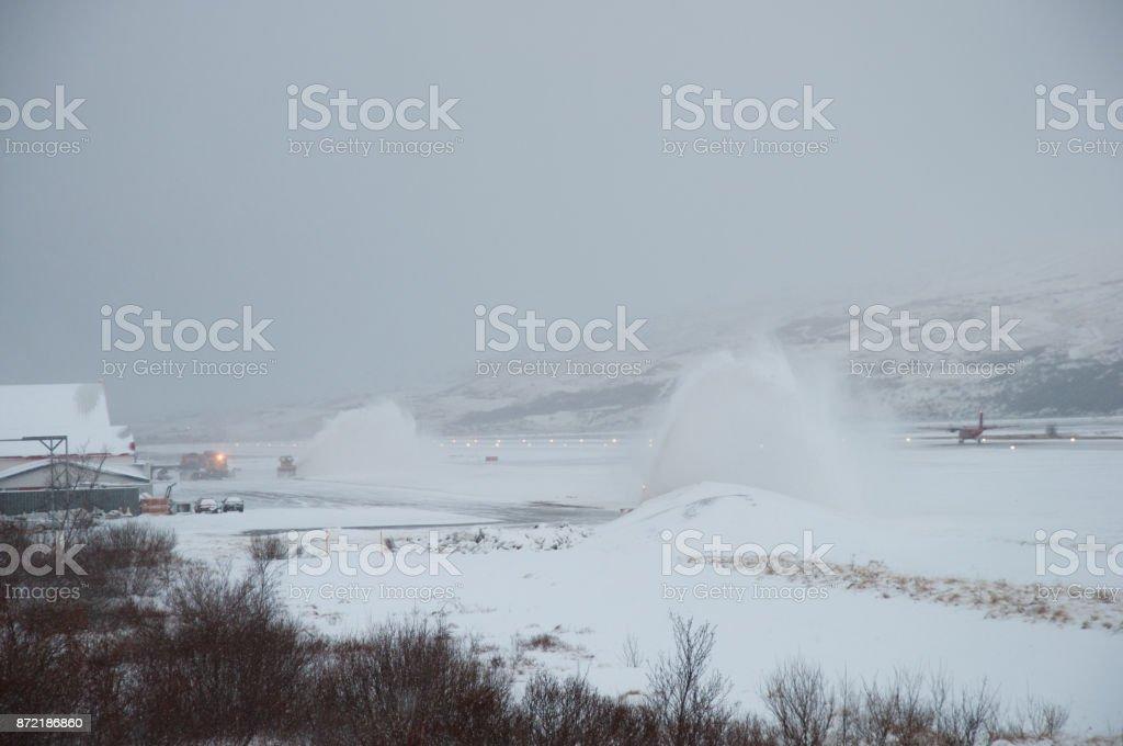 Snowplowing at Akureyri airport in Iceland stock photo