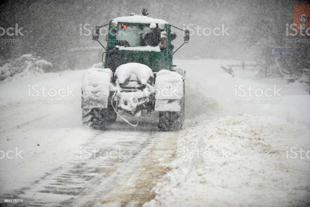 snow-removal equipment on the road royalty-free stock photo