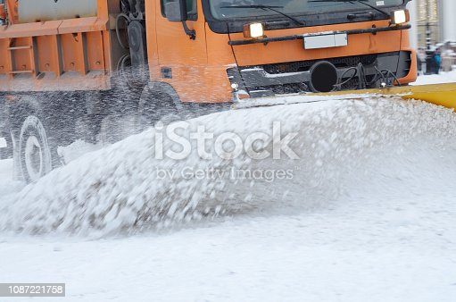 536171925 istock photo Snow-removal vehicles on the streets. 1087221758