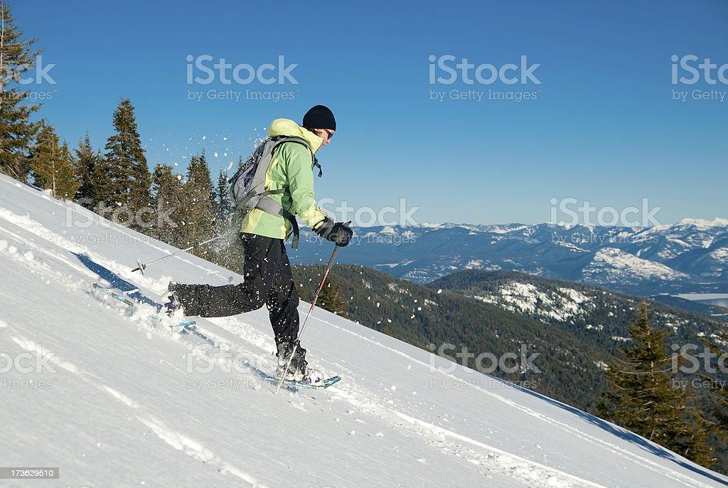 Snowshoeing Gal stock photo