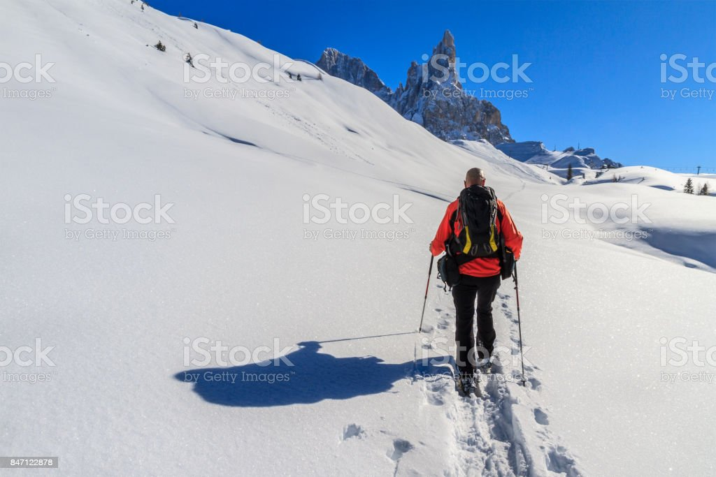 Snowshoeing in the Pale di San Martino Natural Park (Pala Group) in winter, Italy stock photo
