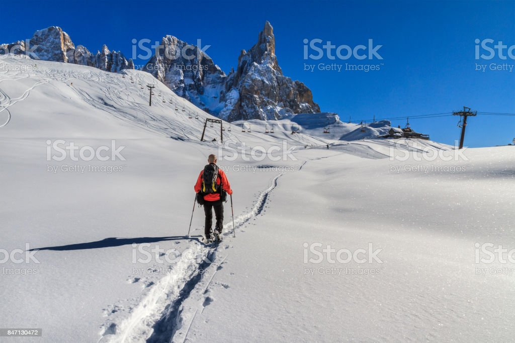 Snowshoeing in the Pale di San Martino Natural Park (Pala Group), Italy stock photo