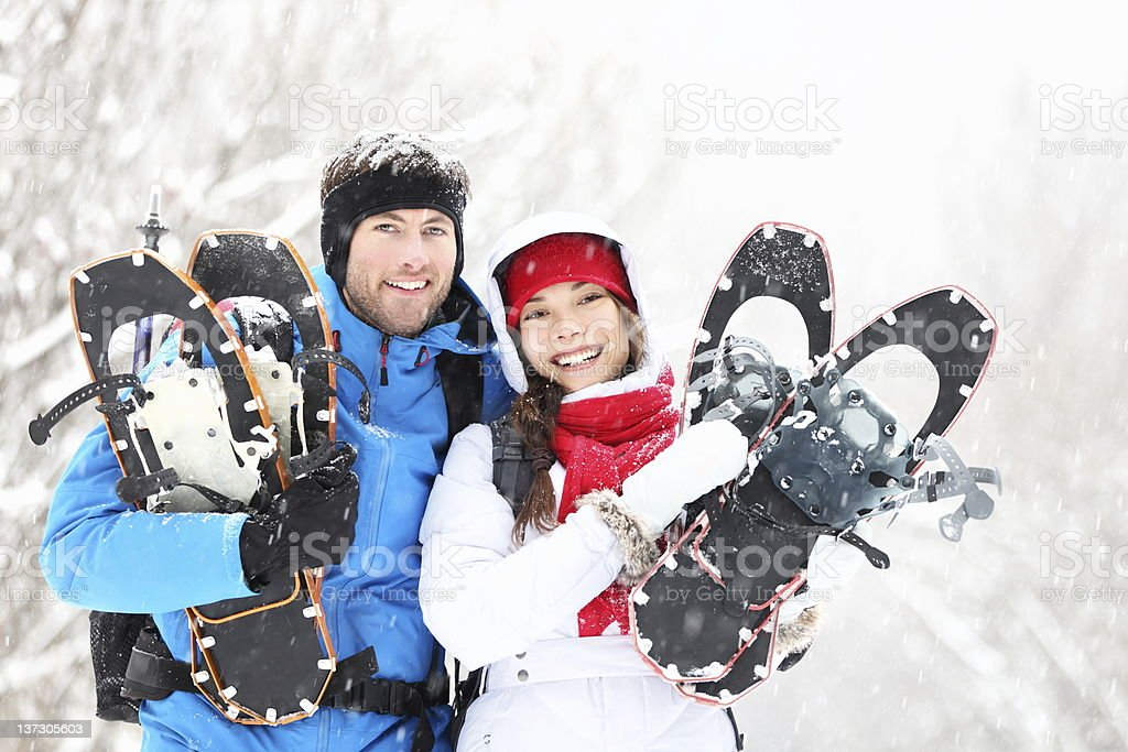 snowshoeing winter hiking couple stock photo