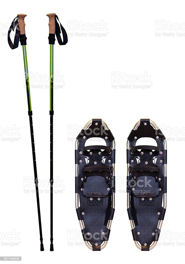 Snowshoes and trekking poles stock photo