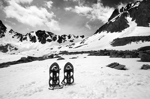 Snowshoes in snow mountain. Turkey, Kachkar Mountains, highest part of Pontic Mountains. Wide angle view. Black and white toned image.