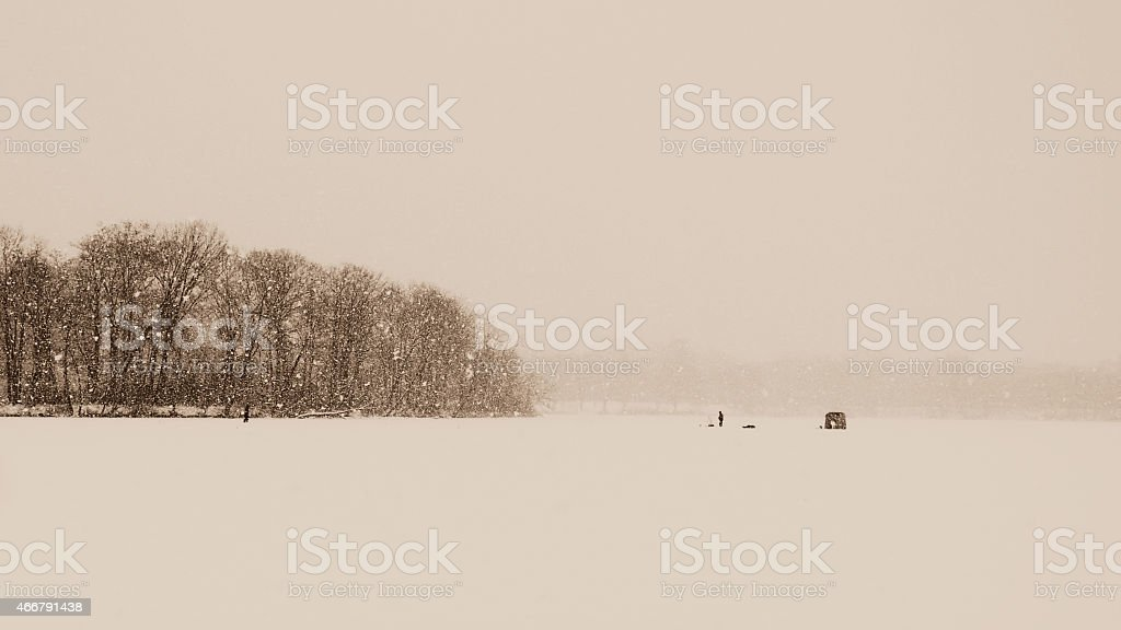 Snowstorm Ice Fishing at Collins Park, Scotia, New York stock photo