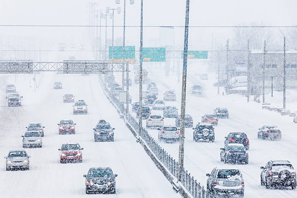Snowstorm on the Highway during Rush Hour stock photo