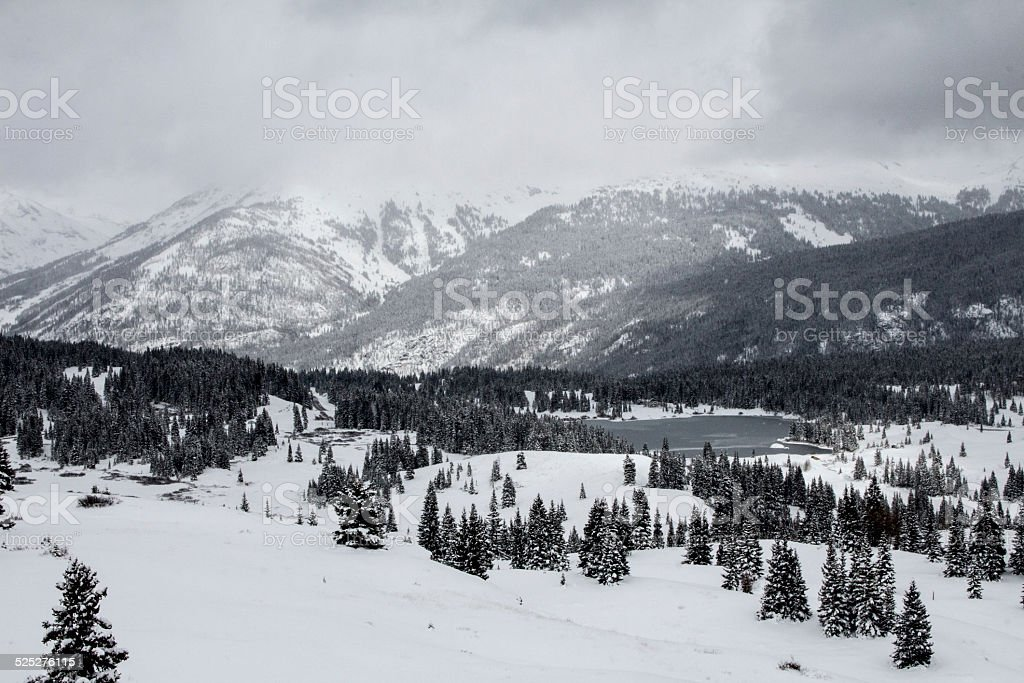 Snowstorm on the Peaks in the Rocky Mountains, CO stock photo