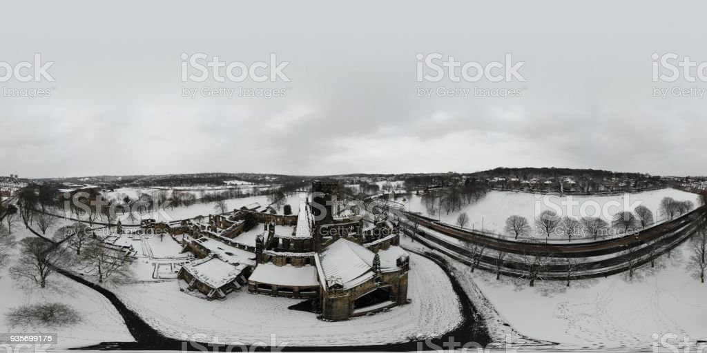 Snowy 360 Degree panoramic aerial photo over am old ruins of a Abbey stock photo
