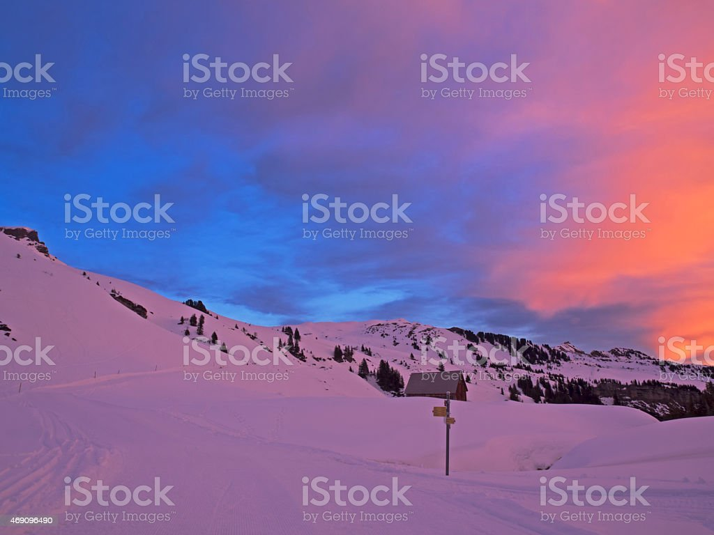 Snowy alpine landscape at dawn stock photo