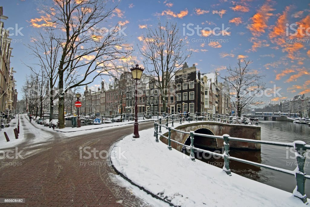 Snowy Amsterdam in winter in the Netherlands at sunrise stock photo
