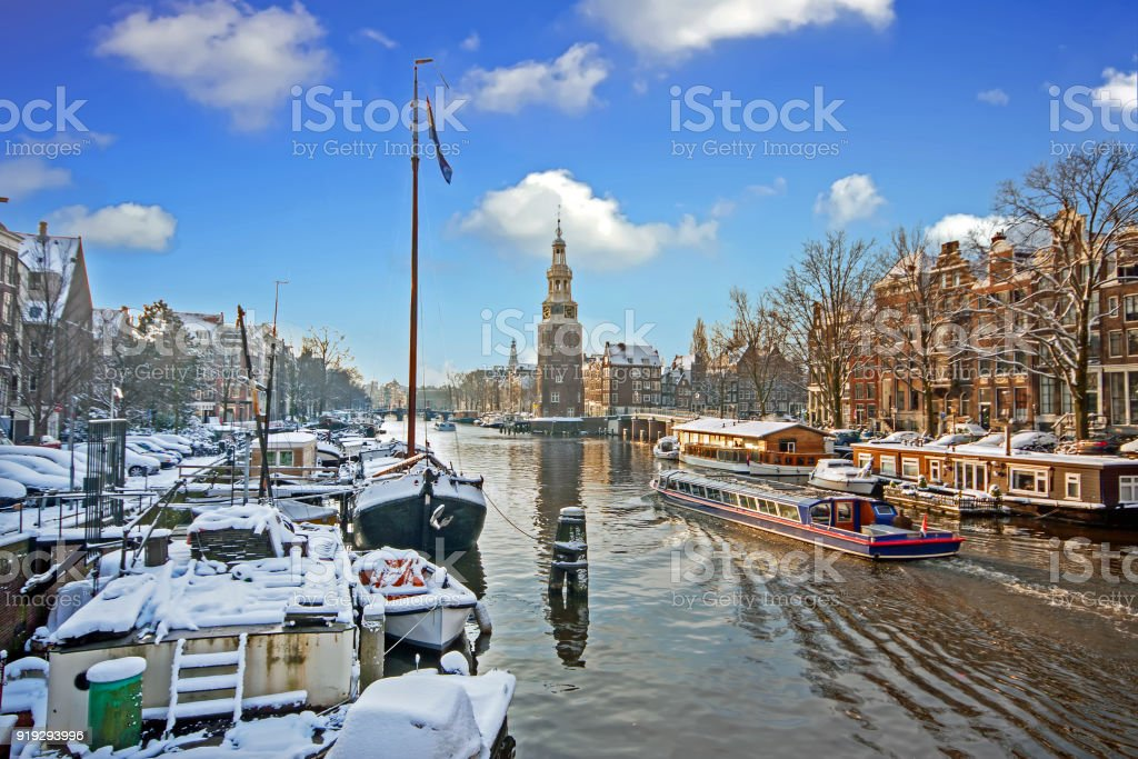 Snowy Amsterdam with the Montelbaan tower in winter in the Netherlands stock photo