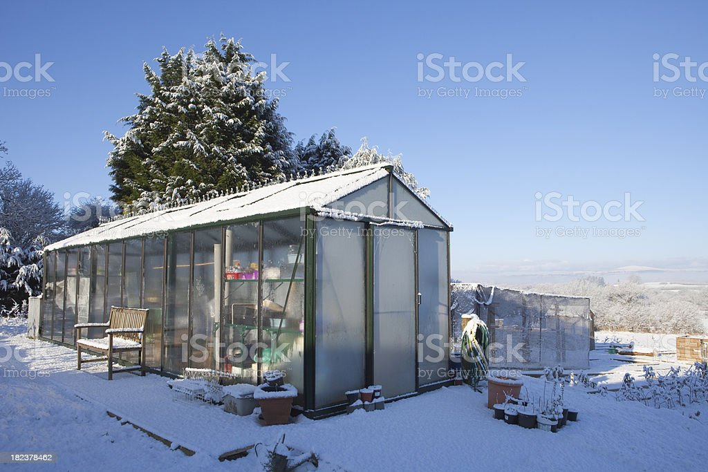 Snowy And Frosty Winter Greenhouse royalty-free stock photo