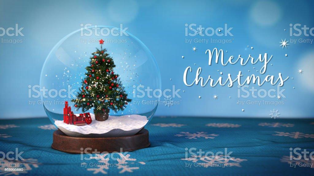 Verschneite Ball mit einem Weihnachtsbaum im Inneren - Stock Bild – Foto