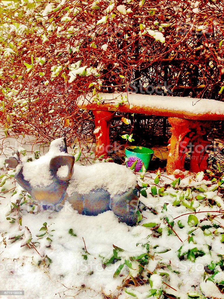 Snowy Bench and Pig Statue stock photo
