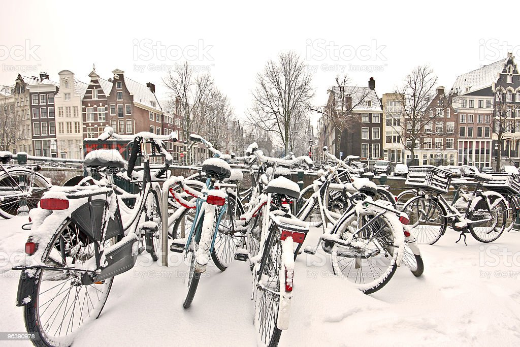 Snowy bikes in the citycenter from Amsterdam Netherlands - Royalty-free Amsterdam Stock Photo