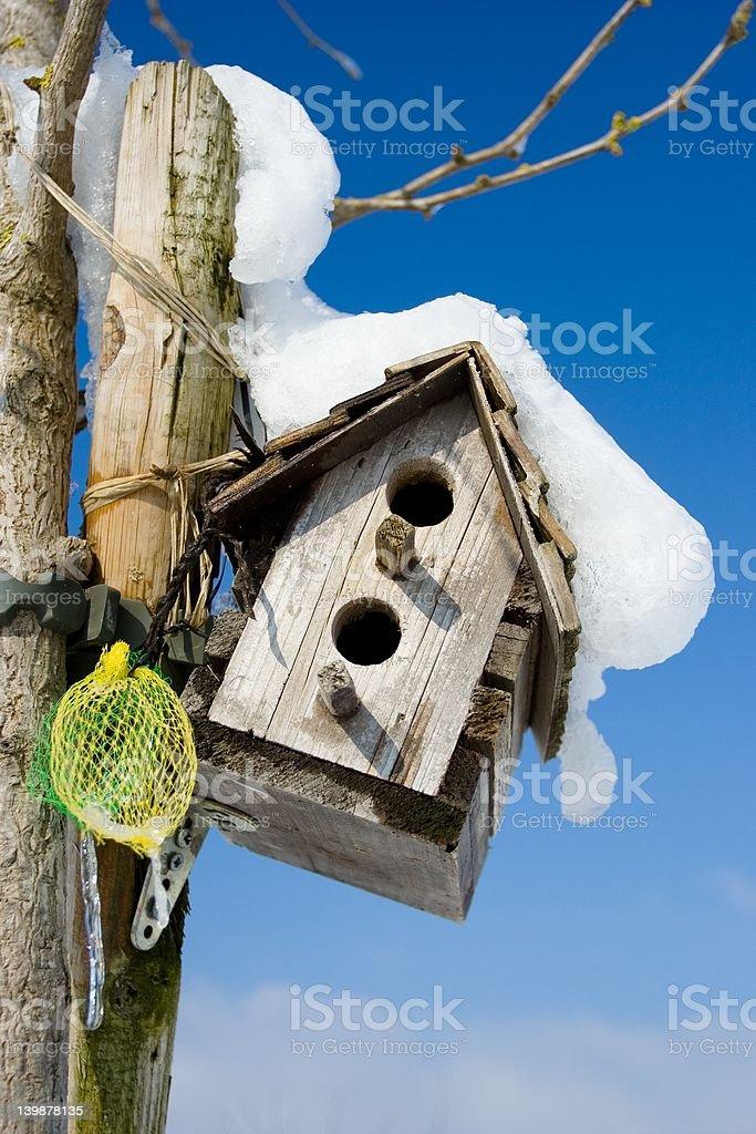 Snowy birdhouse royalty-free stock photo