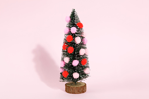 snowy christmas tree decorated with pompoms