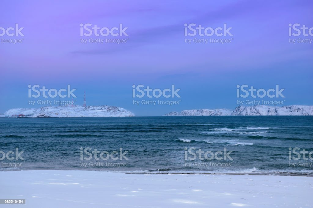 Snowy coast of Barents Sea in Teriberka, Murmansk Region, Russia stock photo