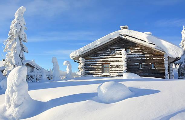 Snowy cottage on mountain stock photo