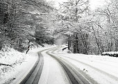 istock Snowy country British road 936972474