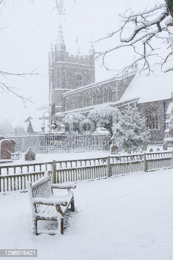 A winter's morning in Beaconsfield Old Town, Buckinghamshire, and a blast of snow blankets the Church of St Mary and All Saints.