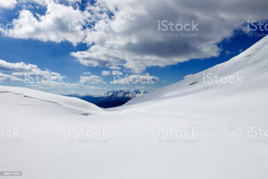 Snowy desert, milky texture of hypnotizing snow at the top of the mountain stock photo