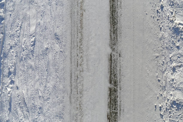 Snowy Driveway Photographed from Above in Finland stock photo