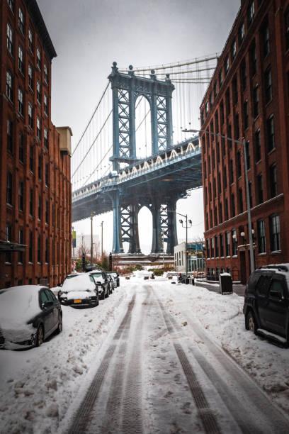 Snowy DUMBO and the Manhattan Bridge stock photo