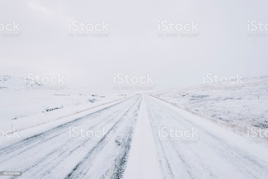 Snowy empty driving road in the winter Iceland royalty-free stock photo
