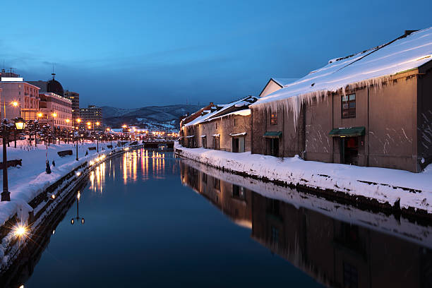 Snowy evening view along the canal in Otaru, Hokkaido, Japan stock photo
