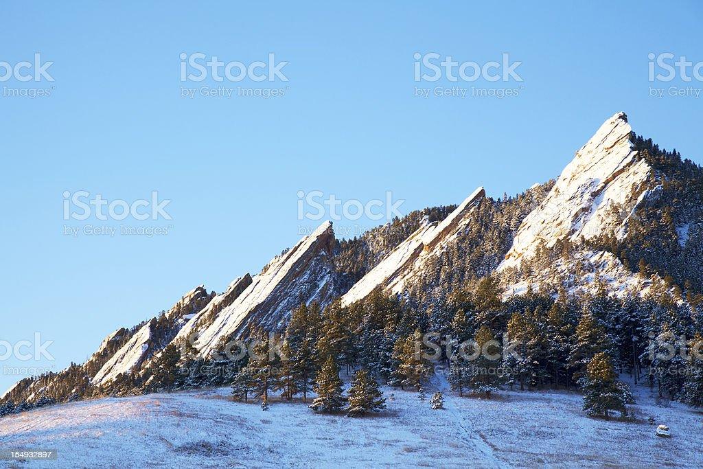 Snowy Flatirons of Boulder Colorado stock photo