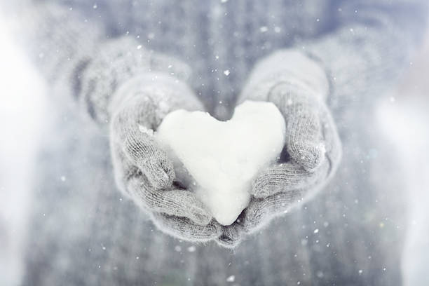 snowy heart - february stock photos and pictures