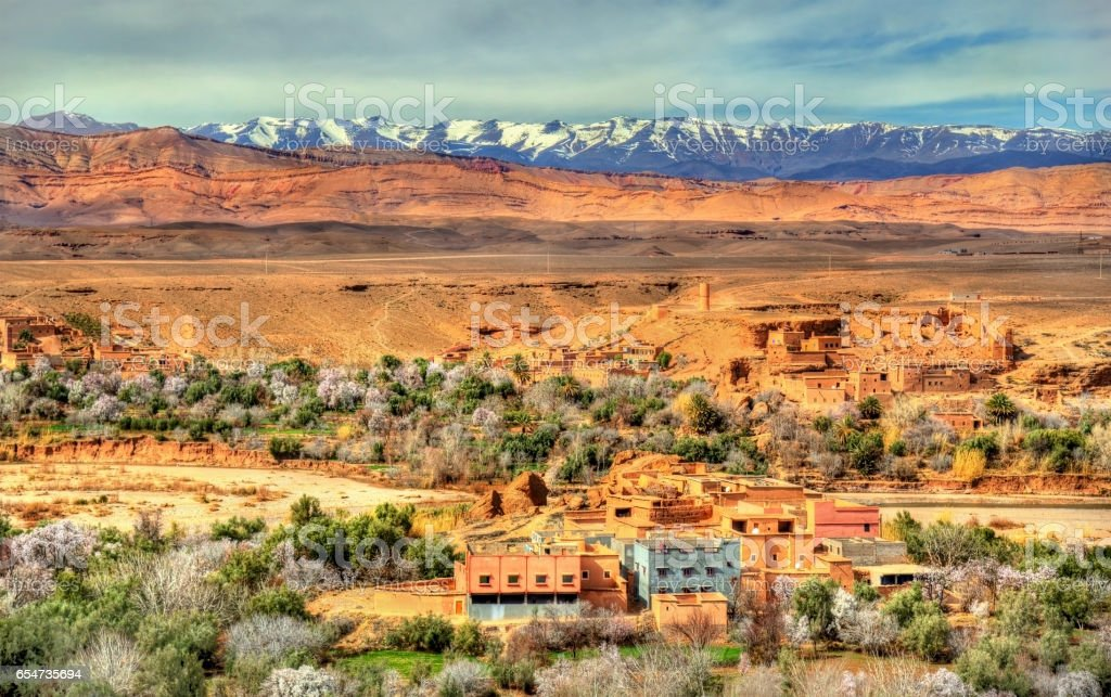 Snowy High Atlas Mountains above Kalaat M'Gouna town in Morocco stock photo