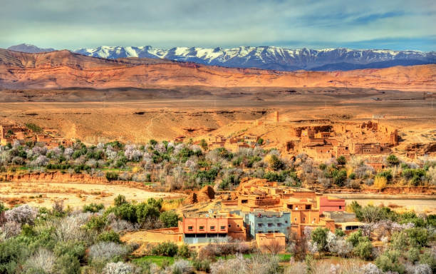 Snowy High Atlas Mountains above Kalaat M'Gouna town in Morocco stock photo