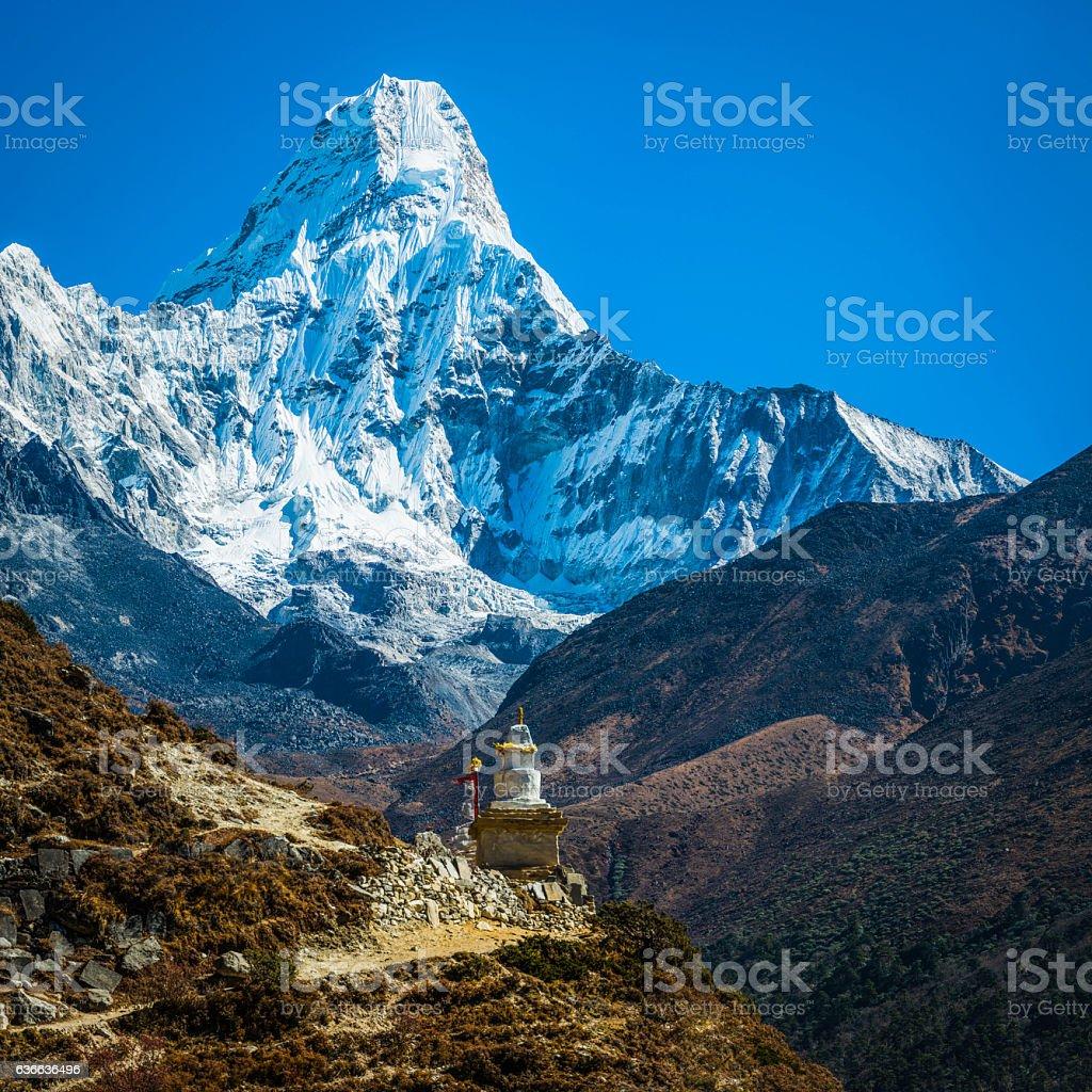Snowy Himalayan mountain peak over Buddhist stupa Ama Dablam Nepal stock photo