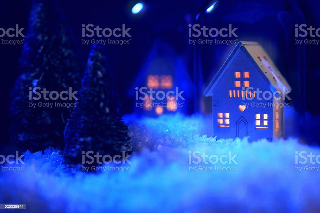 Snowy house at night stock photo