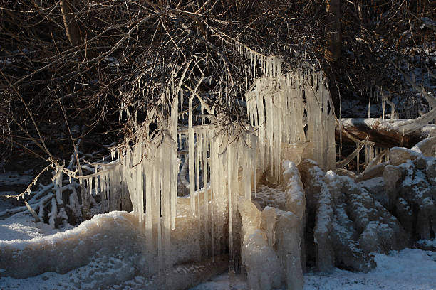 Snowy iced sea and icicles landscape. Winter landscape backgroun stock photo