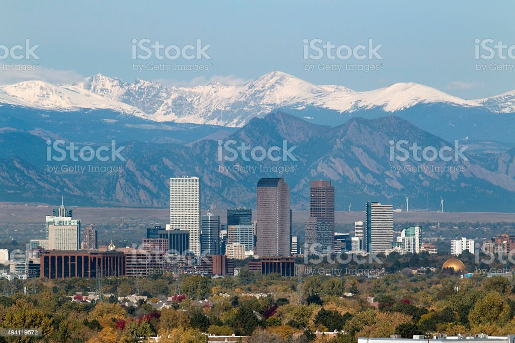 Snowy Indian Peaks and Downtown Denver Colorado skyscrapers stock photo
