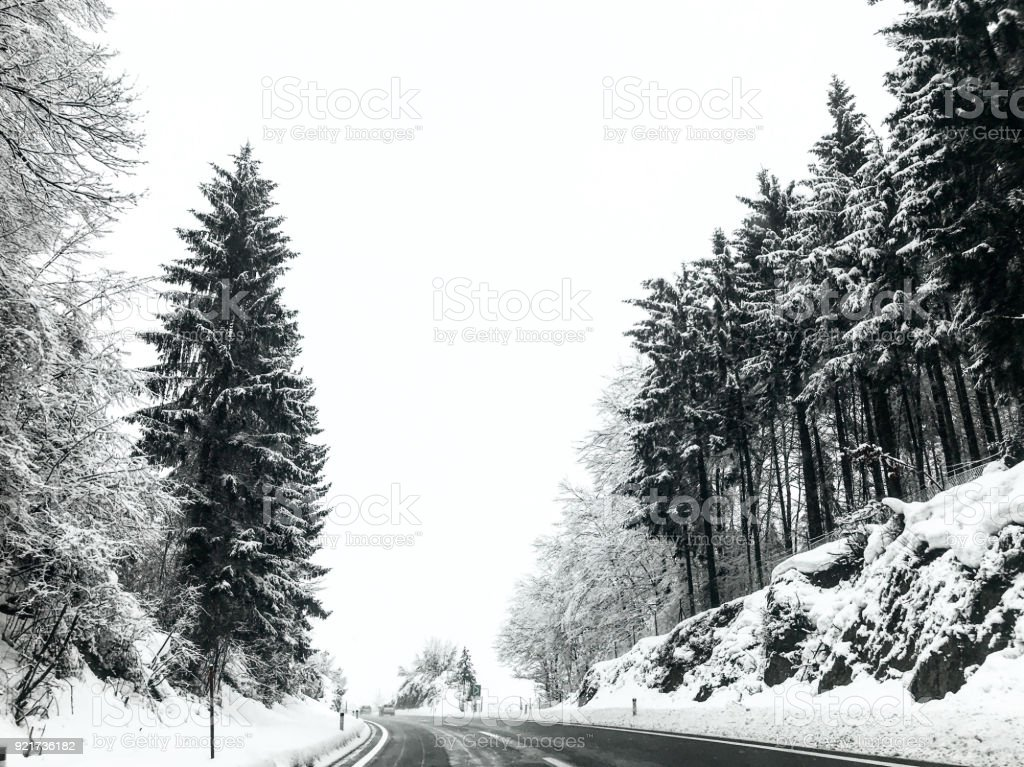 Snowy landscape and the higway with no people stock photo