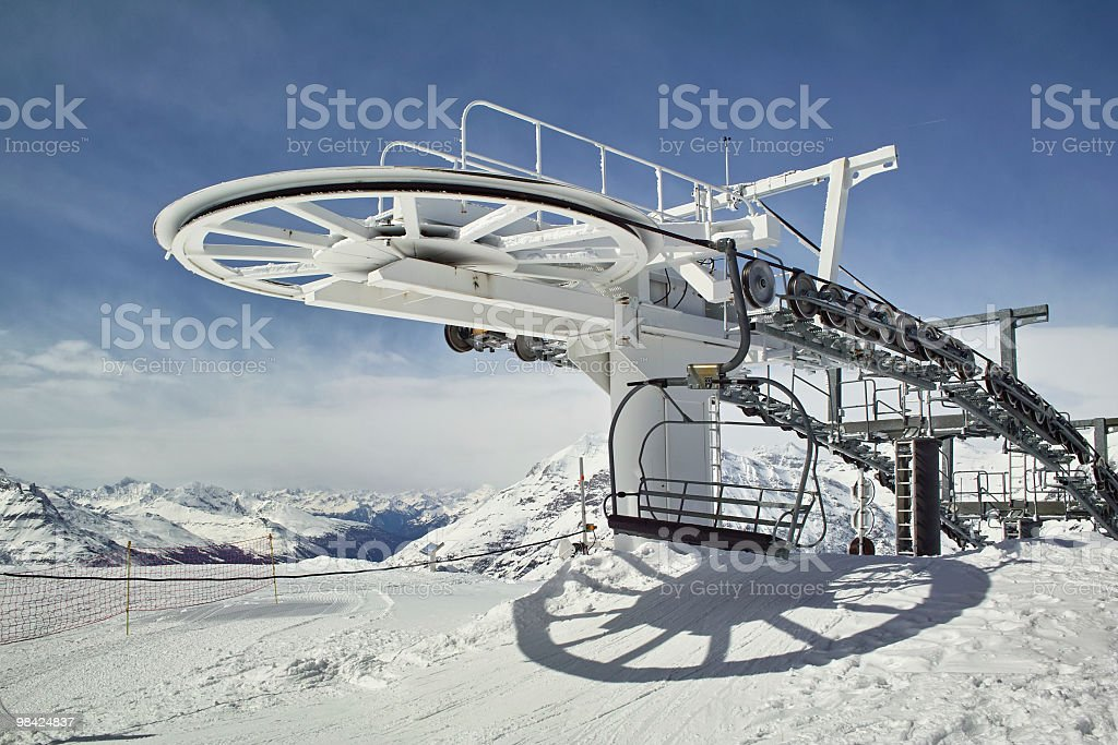 snowy landscape with chairlift in alps royalty-free stock photo