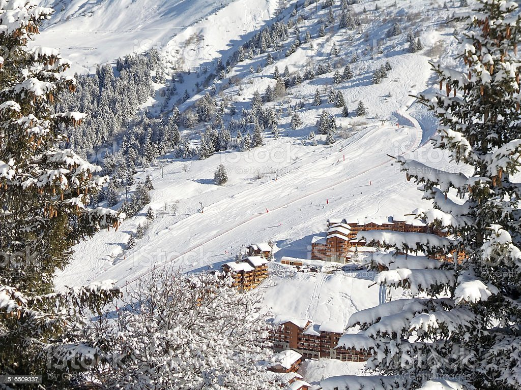Snowy landscape with ski chalets, Meribel, the Alps, France stock photo