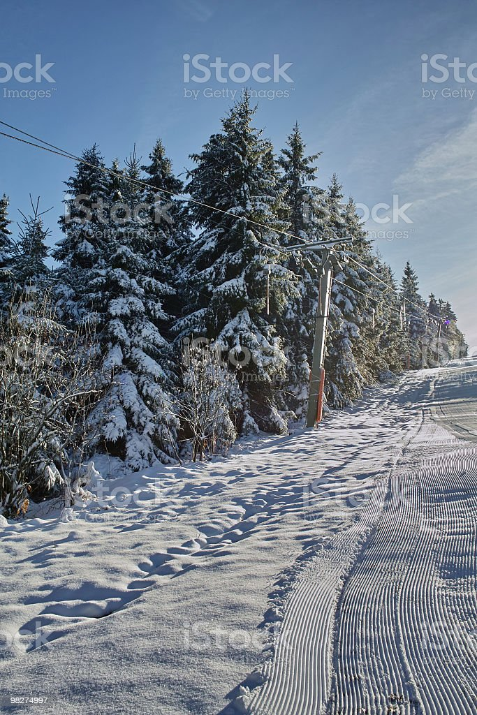 snowy landscape with ski lift royalty-free stock photo