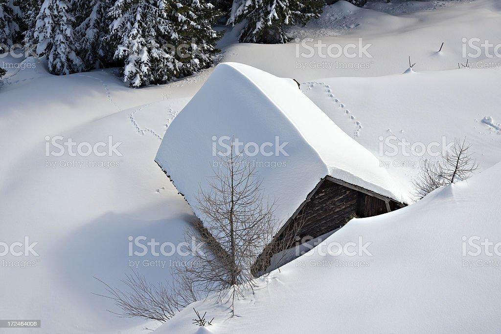 snowy log hut royalty-free stock photo