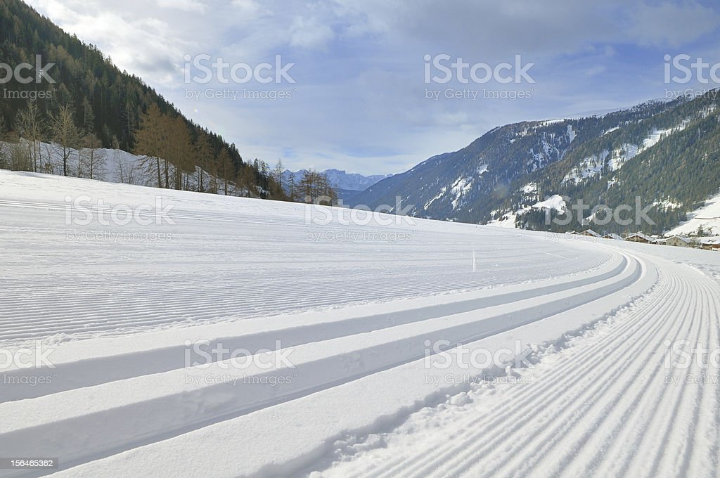 Snowy mountain landscape with cross country track royalty-free stock photo
