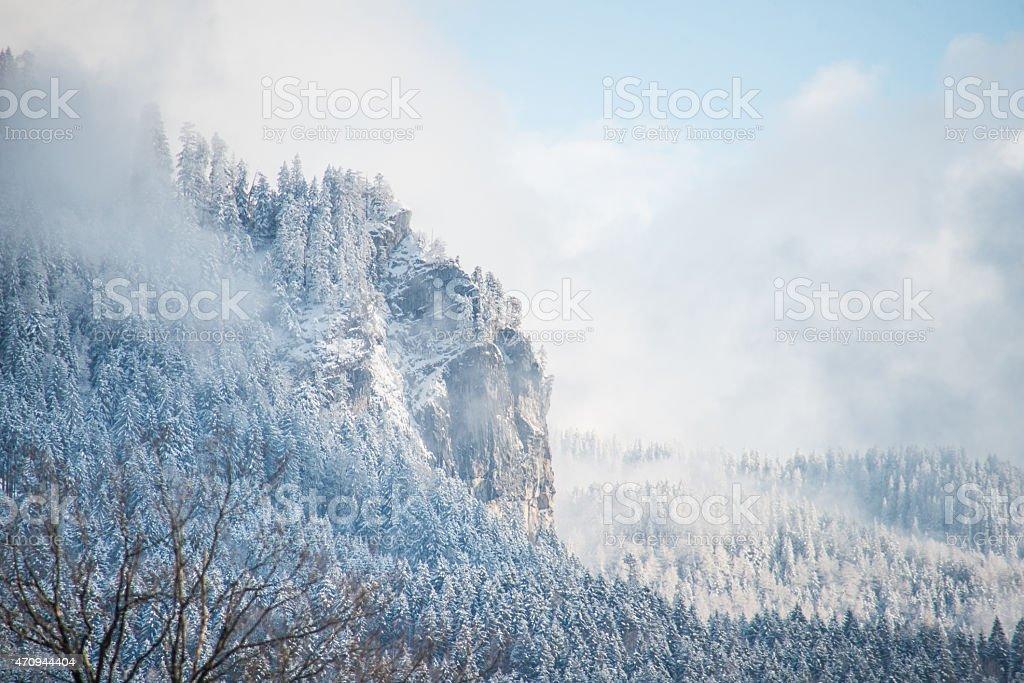 snowy mountain peak with rock stock photo