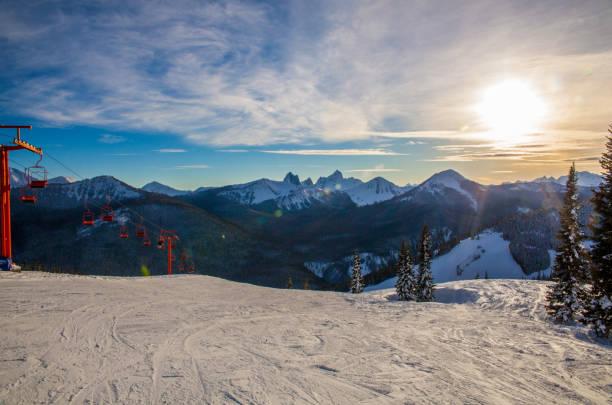 Snowy Mountain Peak with Ski Lift stock photo