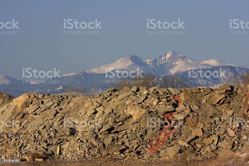 snowy mountain peaks and construction waste disposal royalty-free stock photo